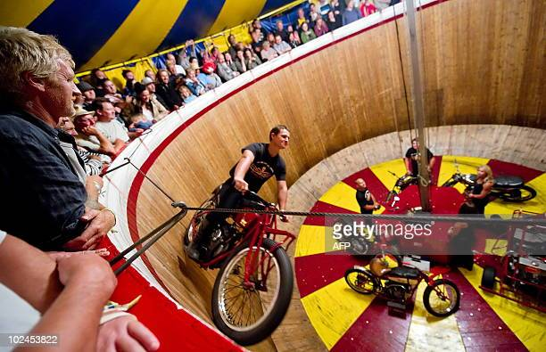 A rider takes to the 'Wall of Death' within the Block 9 area at the Glastonbury festival near Pilton Somerset on June 26 2010 Celebrating its 40th...