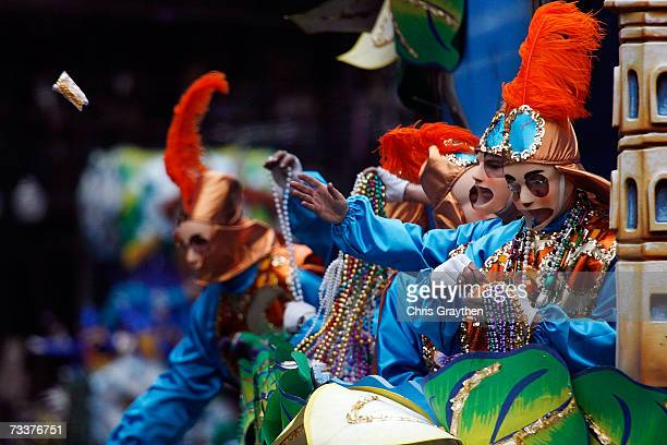 A rider tosses a cup from a float in the Rex parade on Mardi Gras Day February 20 2007 in New Orleans Louisiana Mardi Gras is being celebrated for...