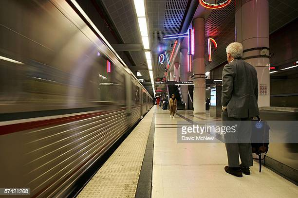 A rider waits to board as a train arrives at the subway stop at Pershing Square on April 25 2006 in Los Angeles California As gasoline prices soar...