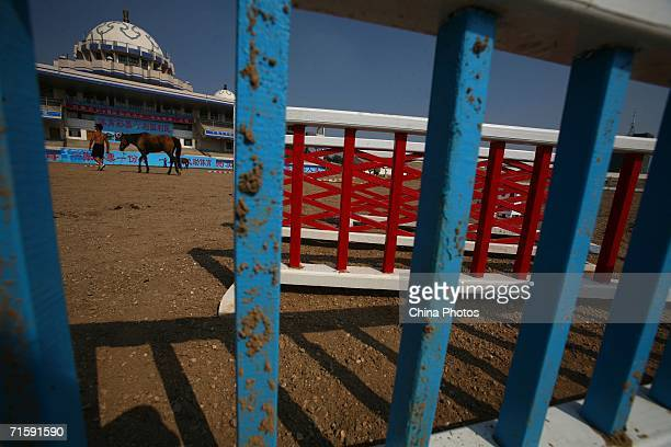 Rider walks his horse at the Inner Mongolia Racetrack on August 4, 2006 in Hohhot of Inner Mongolia Autonomous Region, China. The Inner Mongolia...