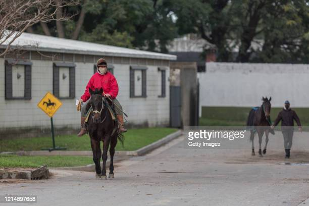 A rider walks through the village during competition day as Uruguay slowly returns to normal due to coronavirus outbreak at Maroñas Horse Track on...