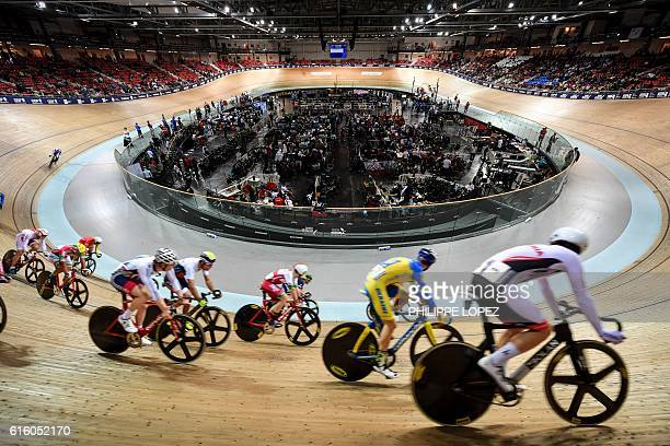 TOPSHOT Rideres compete in the men's Omnium II race during the European Track Cycling Championships in SaintQuentinenYvelines on October 21 2016 /...