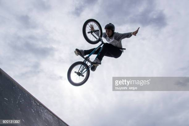 bmx rider,japan,okinawa - acrobatic activity stock photos and pictures