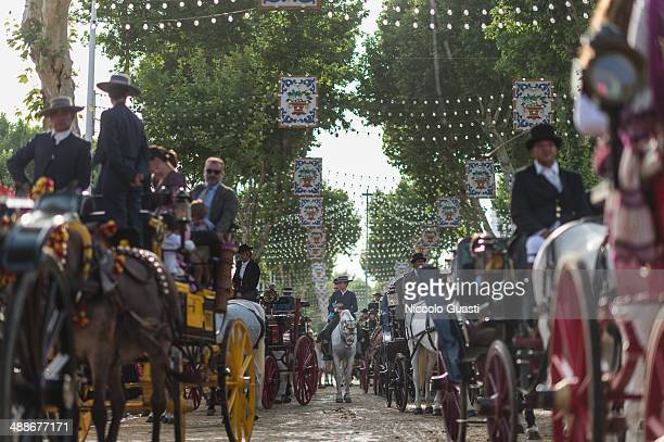 Riders and horsedrawn carriages at the 'Feria de Abril 2014' on May 7 2014 in Seville Spain