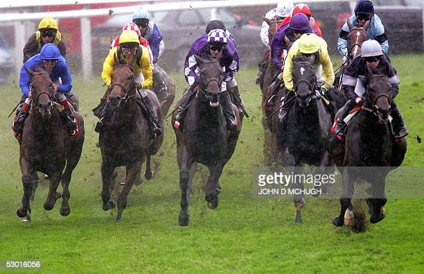 Riders and horses bunch at Tattenham Corner in the last race of the day, the Group Services Handicap Stakes, at the Epsom Downs Derby on Ladies Day,...