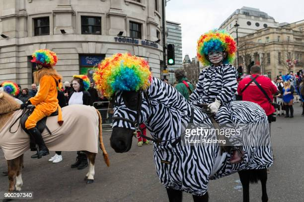 Riders and horses in fancy dress from All the Queens Horses group take part in London's New Year's Day Parade 2018 Around 500000 spectators gather...