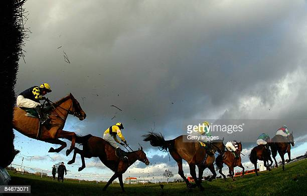 Riders and horses land a fence during the Betfair Handicap Steeple Chase at BangorOnDee Racecourse on February 6 2009 in BangorOnDee Wales