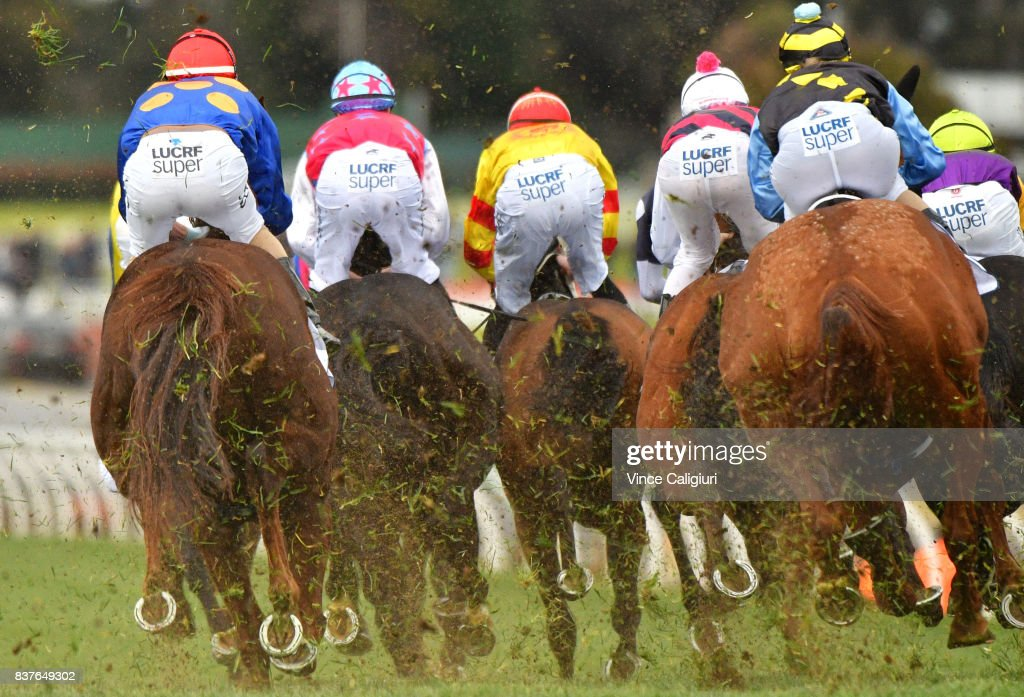 Riders and horses turn into home straight in Race 6 during Melbourne Racing at Sandown Hillside on August 23, 2017 in Melbourne, Australia.