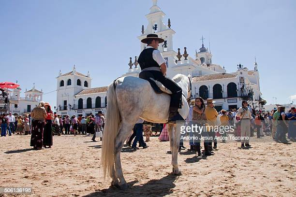 Riders and pilgrims in front of the Shrine of the Virgin of El Rocio dressed in traditional clothing waiting for the presentations of the...