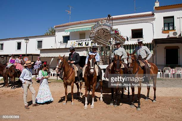 Riders and pilgrims of the Brotherhood of Rocio from Murcia, in front of their House, guarding the Carreta of Simpecado, waiting to make their...