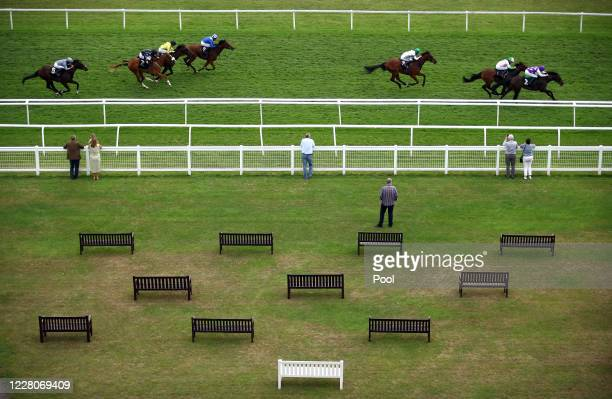 Riders and racers during the Unibet EBF Maiden Stakes race at Newbury Racecourse on August 16 2020 in Newbury England