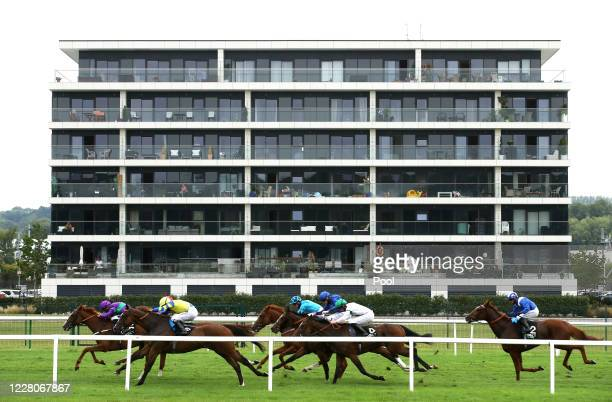 Riders and racers in action during the Unibet You're On Handicap race at Newbury Racecourse on August 16, 2020 in Newbury, England.