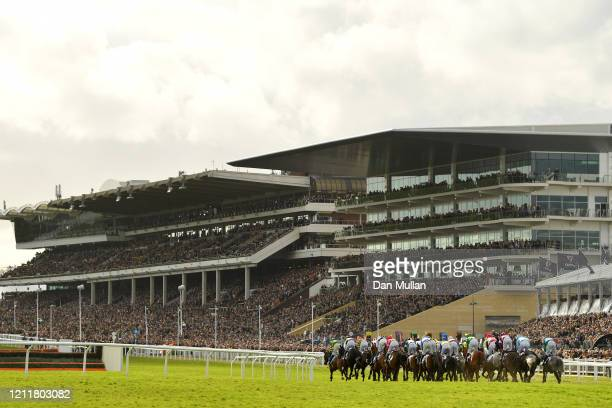 Riders and runners during the Coral Cup Handicap Hurdle at Cheltenham Racecourse on March 11, 2020 in Cheltenham, England.