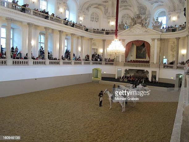Riders and their horses during Morning Exercise inside the practice facility of the Spanish Riding School in Vienna, Austria, home of the...