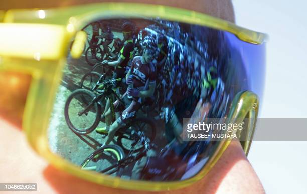 Riders are reflected in sunglasses during the 14th edition of the Hero MTB Himalaya mountain bike race during a final day at Dharamshala in the...
