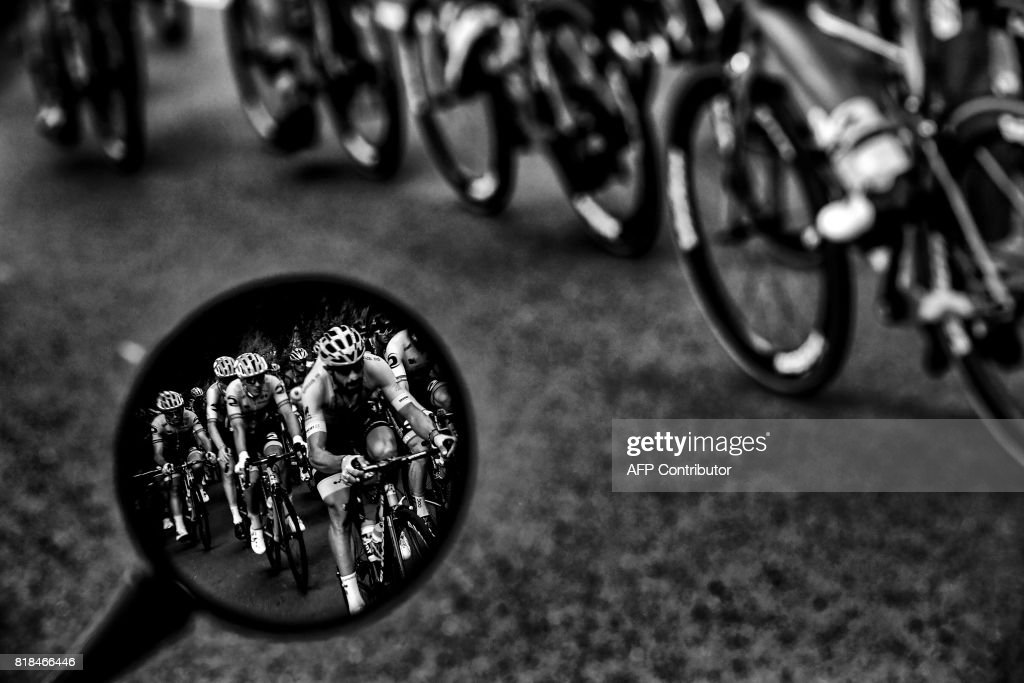 Riders are seen in a wing mirror during the 178 km tenth stage of the 104th edition of the Tour de France cycling race on July 11, 2017 between Perigueux and Bergerac. /