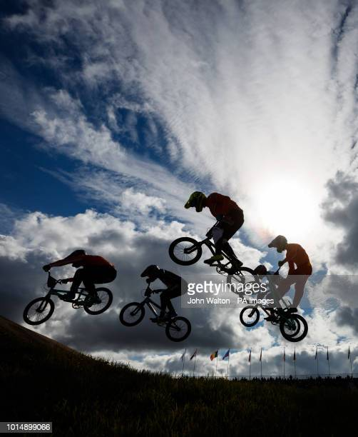 Riders are silhouetted against the sky during the men's 1/8 finals during day ten of the 2018 European Championships at the Glasgow BMX Centre Track