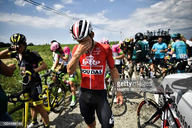 Riders clean their stinging eyes after tear gas was used during a farmers' protest who attempted to block the stage's route during the 16th stage of...