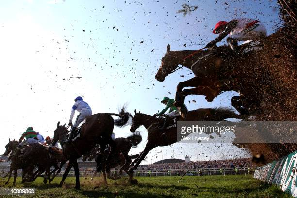 Riders clear a fence in the Betway Handicap Chase during Grand National Day at Aintree Racecourse on April 06 2019 in Liverpool England
