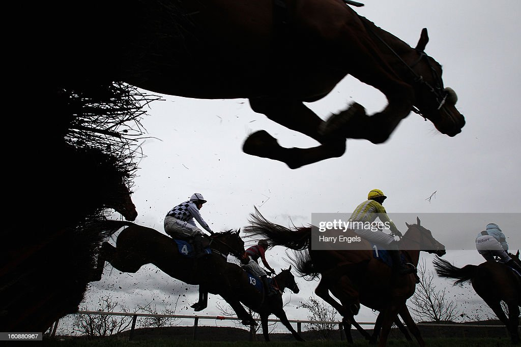Riders clear a hurdle during the Ladies Day 24th April Maiden Hurdle Race at Taunton Racecourse on February 7, 2013 in Taunton, England.