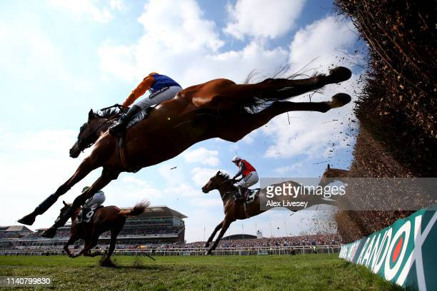 Riders clear a jump in the Doom Bar Maghull Novices' Chase during Grand National Day at Aintree Racecourse on April 06, 2019 in Liverpool, England.