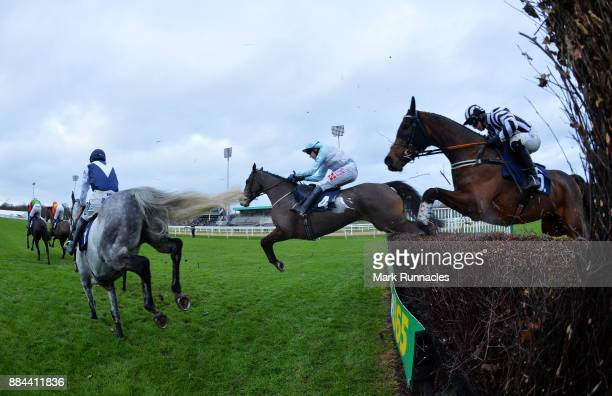 Riders clear the final fence during the Weatherbys General Book Online Steeple Chase at Newcastle Racecourse on December 2 2017 in Newcastle upon...