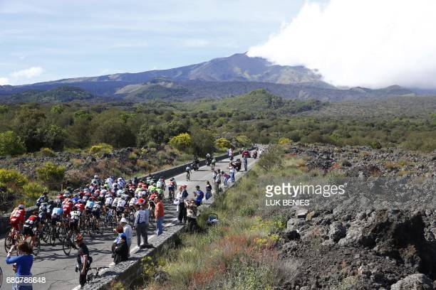 Riders climb in direction of the Mount Etna during the 4th stage of the 100th Giro d'Italia Tour of Italy cycling race from Cefalu to Etna volcano on...