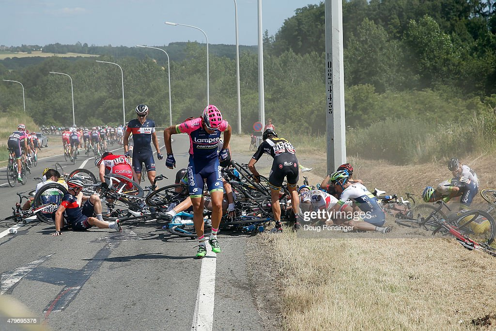 Riders collect themselves after a crash with 65km left to race in stage three of the 2015 Tour de France from Anvers to Huy on July 6, 2015 in Huy, Belgium.