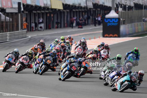 Riders compete at the start of the Moto2 race of the European Grand Prix at the Ricardo Tormo circuit in Valencia on November 8, 2020.