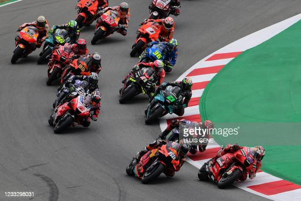 Riders compete at the start of the MotoGP race of the Moto Grand Prix de Catalunya at the Circuit de Catalunya on June 6, 2021 in Montmelo on the...