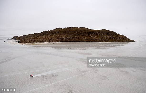 Riders compete during 2015 Dakar Rally stage 8 between Uyuni Bolivia and Iquique Chile on January 12 2015 The Uyuni salt flat is the largest in the...