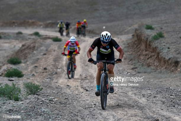 Riders compete during a bicycle orienteering challenge at Shirengou scenic area on May 17, 2020 in Urumqi, Xinjiang Uyghur Autonomous Region of China.