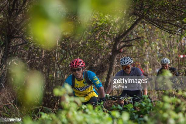 MTB riders compete during Rhino MTB XC Marathon at Tanjung Lesung forest in Banten Indonesia on September 29 2018 More than 100 athletes and sport...