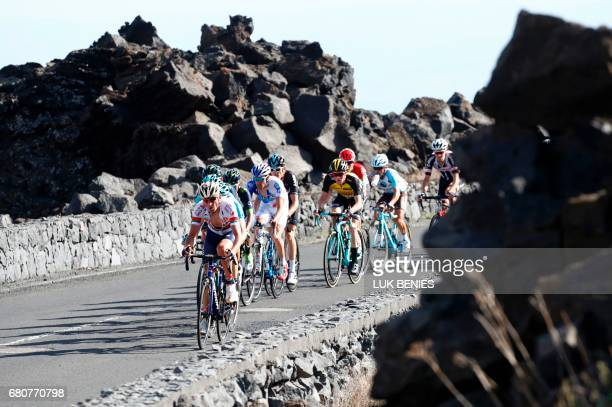 Riders compete during the 4th stage of the 100th Giro d'Italia Tour of Italy cycling race from Cefalu to Etna volcano on May 9 2017 in Sicily...