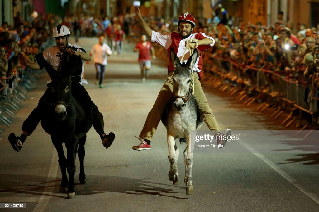Riders compete during the 87th Palio dei Ciuchi (donkey race) on August 14, 2017 in Roccatederighi, Grosseto, Italy. Palio dei Ciuchi' (Donkey race) represents with the Medioevo nel Borgo the main event of a medieval festival held in the Maremma's village of Roccatederighi. At one time the ciuchi (donkey) was an indispensable part of life for the citizens of this little town, and they celebrate the animal in a race held on the 14th of August.