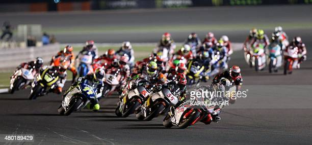 Riders compete during the final of the Moto2 race during the Qatar Grand Prix on March 23 2014 at the Losail International Circuit in the Qatari...