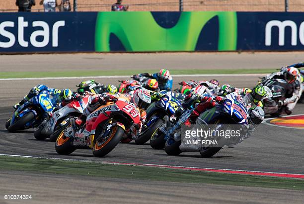 Riders compete during the Moto GP race of the Aragon Grand Prix at the Motorland racetrack in Alcaniz on September 25 2016 / AFP / JAIME REINA
