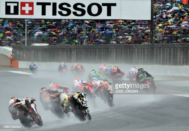 TOPSHOT Riders compete during the MotoGP race of the Valencia Grand Prix at the Ricardo Tormo racetrack in Cheste on November 18 2018