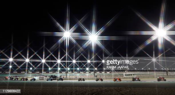 TOPSHOT Riders compete during the Qatar MotoGP grand prix at the Losail track in Qatar's capital Doha on March 10 2019