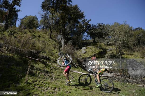 Riders compete in the 14th edition of the Hero MTB Himalaya mountain bike race in the northern Indian state of Himachal Pradesh on October 5 2018 The...
