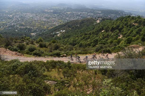 Riders compete in the 14th edition of the Hero MTB Himalaya mountain bike race during a final day at Dharamshala in the northern Indian state of...