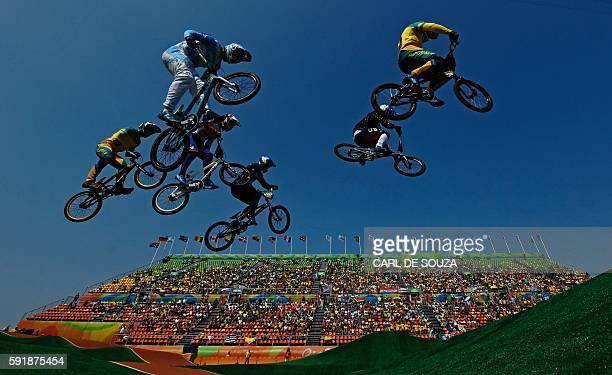 TOPSHOT Riders compete in the BMX cycling men's quarterfinals event at the XPark BMX venue in Deodoro during the Rio 2016 Olympic Games in Rio de...