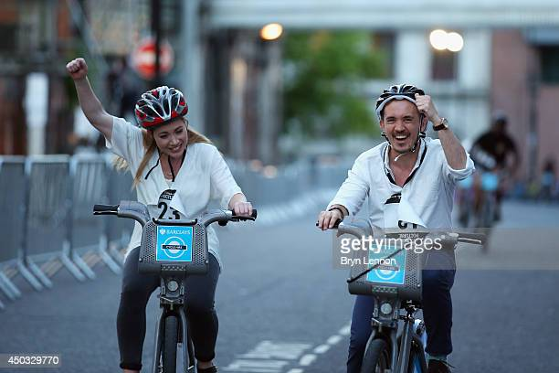 Riders compete in the Boris Bike race during the Jupiter London Nocturne on June 7 2014 at Smithfield Market England