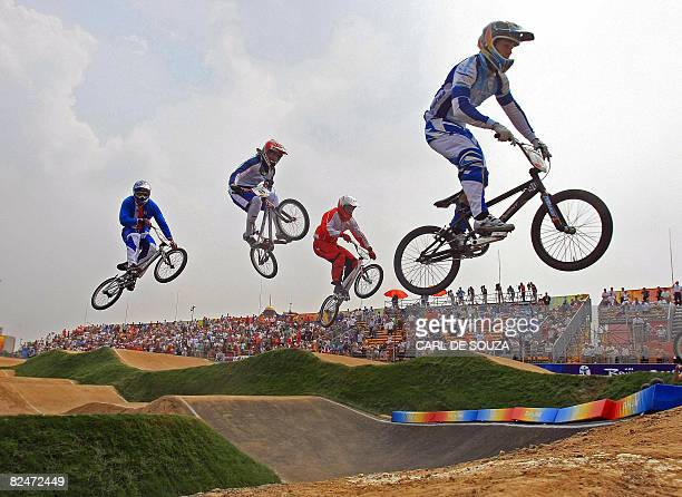 Riders compete in the men's BMX quarterfinals of the 2008 Beijing Olympic Games at the Laoshan BMX Venue, in Beijing on August 20, 2008. AFP...