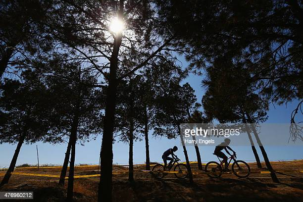 Riders compete in the Men's Crosscountry Mountain Bike Cycling during day one of the Baku 2015 European Games at Mountain Bike Velopark on June 13...