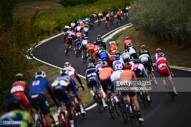 Riders compete in the Men's Elite Road Race, a 258.2-kilometer route around Imola, Emilia-Romagna, Italy, on September 27, 2020 as part of the UCI...