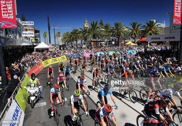 Riders compete in the neutral zone down Jetty Road Glenelg at the start of stage three of the 2018 Tour Down Under on January 18 2018 in Adelaide...