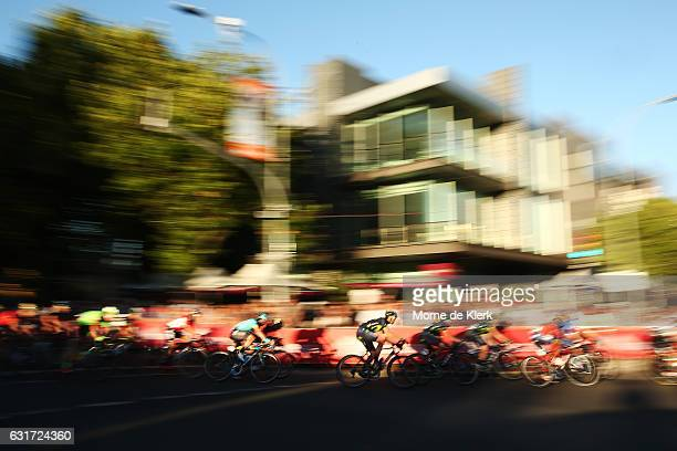 Riders compete in the peleton during the People's Choice Classic street race, a preview race to the 2017 Tour Down Under on January 15, 2017 in...