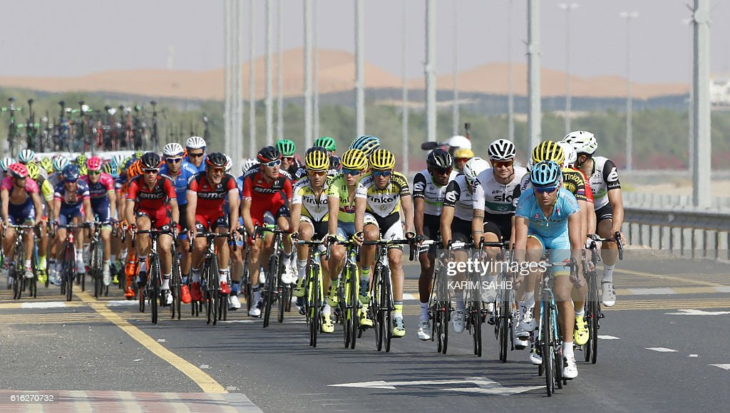 Riders compete in the third stage of the Abu Dhabi Cycling Tour on October 22, 2016, in Al-Ain. Starting from Al-Ain, the route leads, via two intermediate sprints, to the decisive climb of the race, Jebel Hafeet, where the finish lies at an altitude of 1025 metres after 150km. / AFP / KARIM