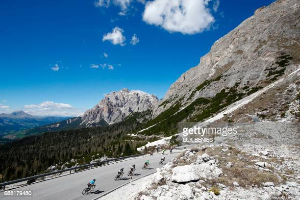 Riders compete in the Valparola pass during the 18th stage of the 100th Giro d'Italia Tour of Italy cycling race from Moena to Ortisei on May 25 2017...